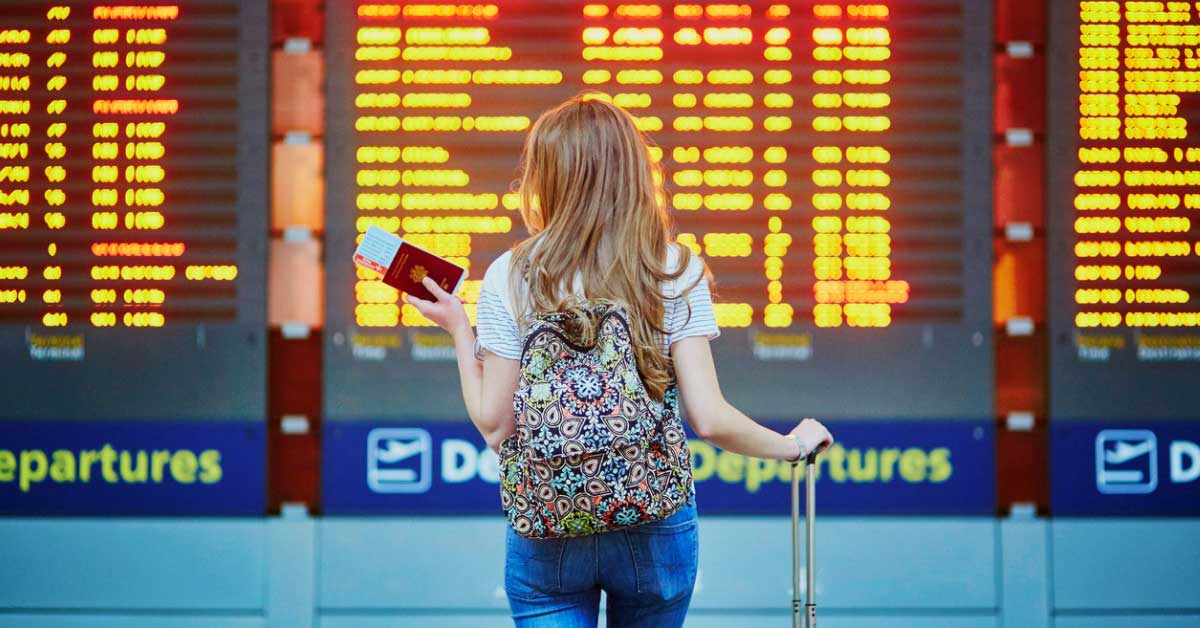 tourist girl with backpack in international airport picture
