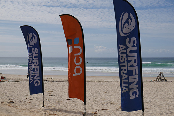 sponsorship flags in the sand